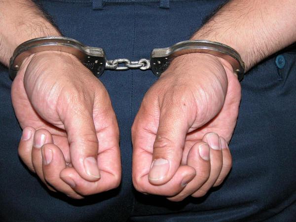 man in handcuffs generic