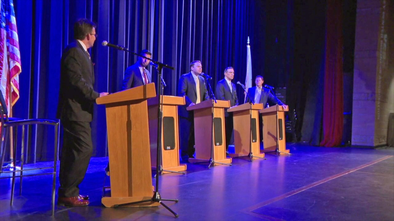 Candidate rushes the stage at 50th District debate