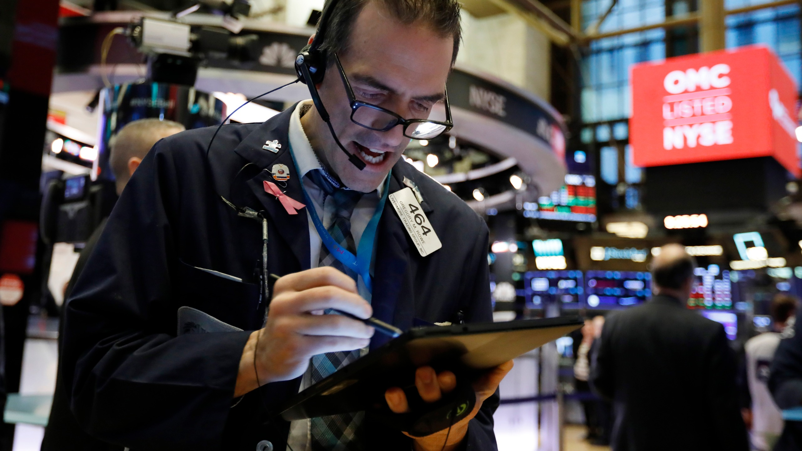 Trader Gregory Rowe works on the floor of the New York Stock Exchange, Monday, Feb. 24, 2020. Stocks are opening sharply lower on Wall Street, pushing the Dow Jones Industrial Average down more than 700 points, as virus cases spread beyond China, threatening to disrupt the global economy. (AP Photo/Richard Drew)