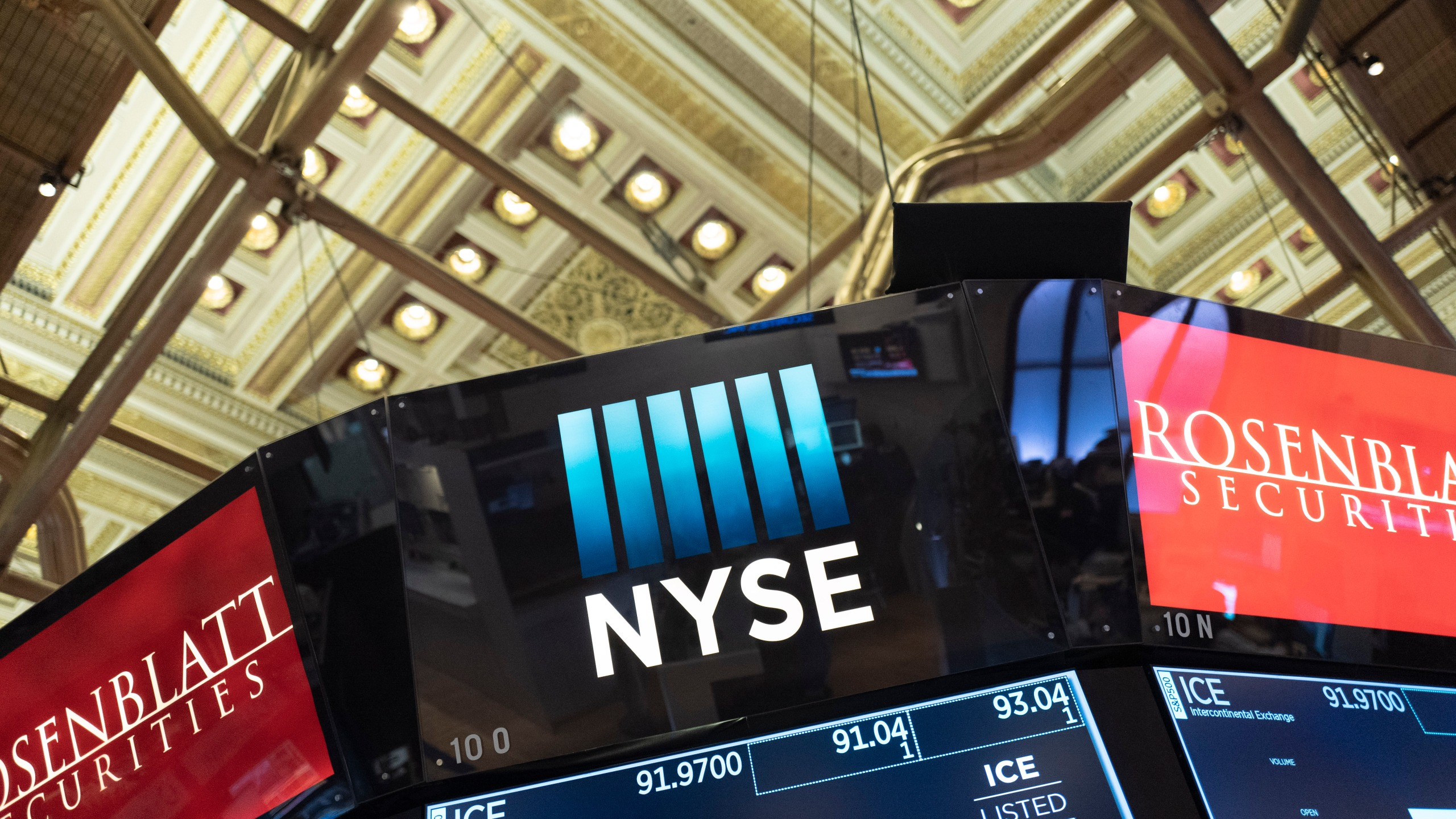 Electronic screens are displayed at the New York Stock Exchange, Wednesday, Feb. 26, 2020. (AP Photo/Mark Lennihan)