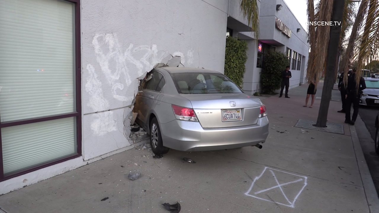 Driver suspected of DUI after crashing into dentist's office