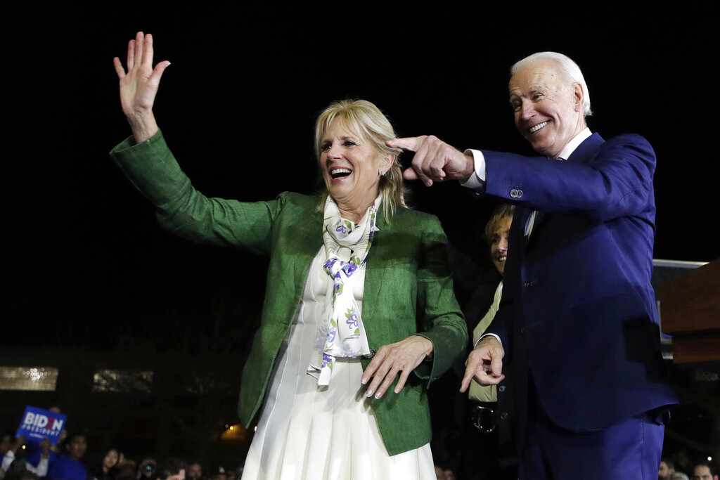 Democratic presidential candidate former Vice President Joe Biden, right, and his wife Jill attend a primary election night rally Tuesday, March 3, 2020, in Los Angeles. (AP Photo/Marcio Jose Sanchez)