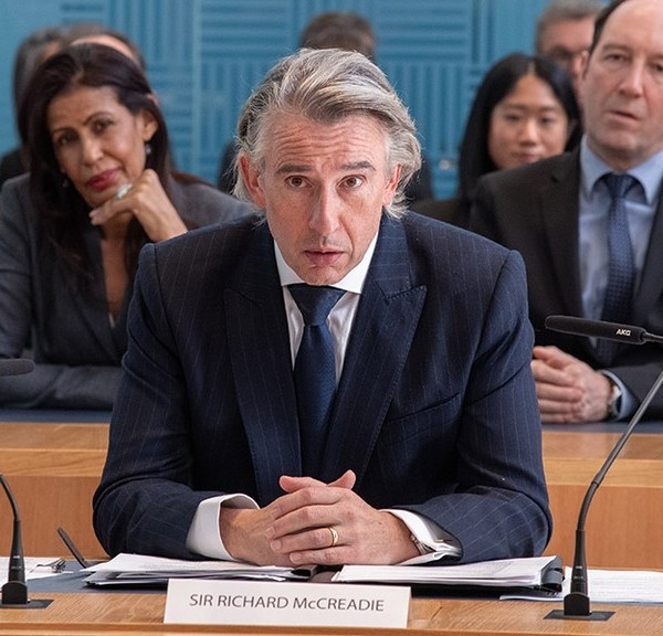 Steve Coogan, playing the type of character he does best.