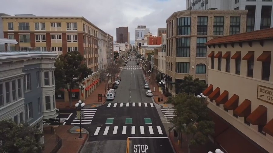 Streets in San Diego's once-bustling Gaslamp Quarter have been deserted during the coronavirus pandemic, and bars and restaurants have been forced to close.