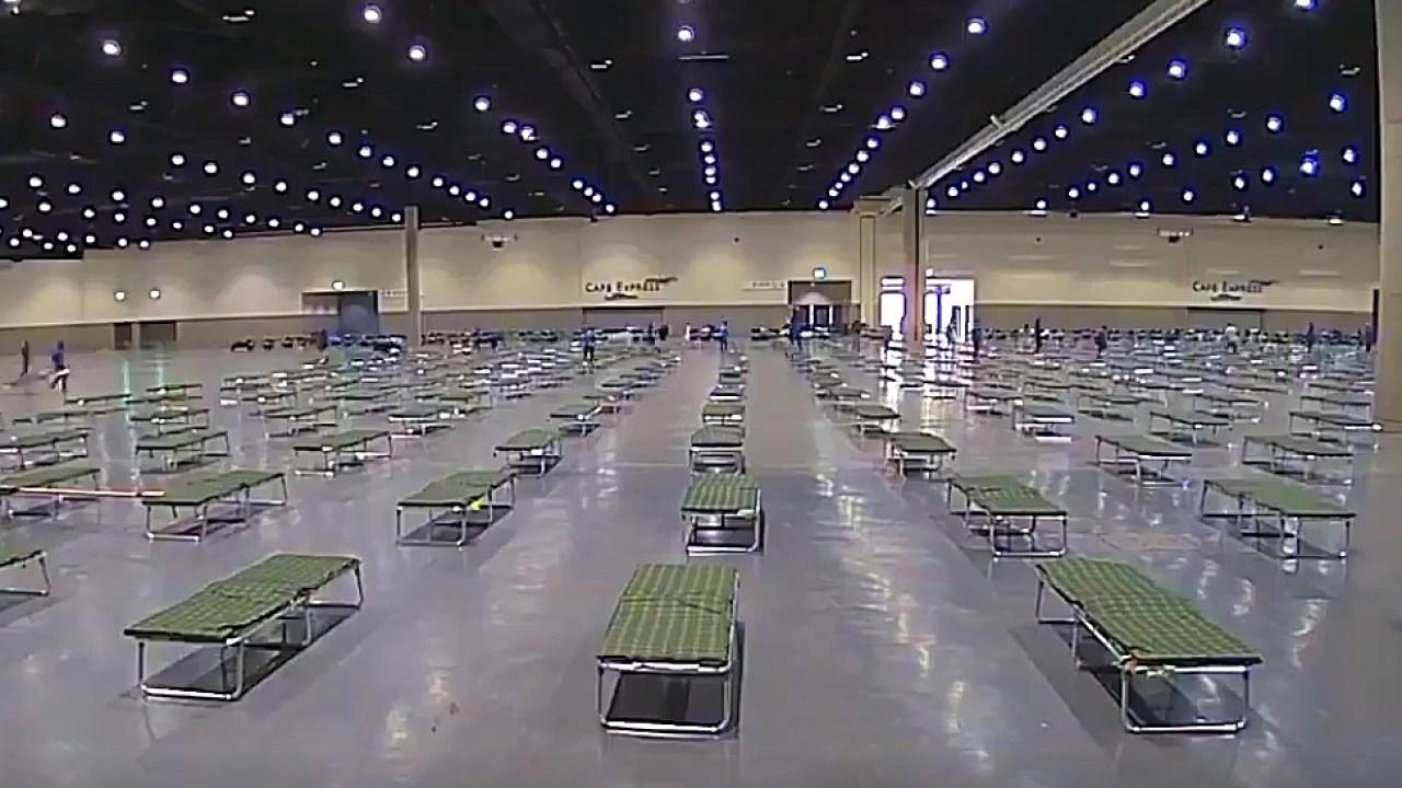 Hundreds more move into convention center homeless shelter