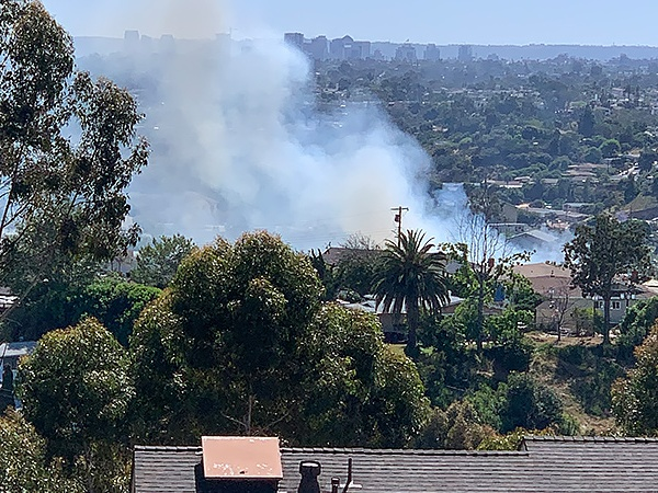 A canyon brush fire threatened homes in the El Cerrito neighborhood Thursday.