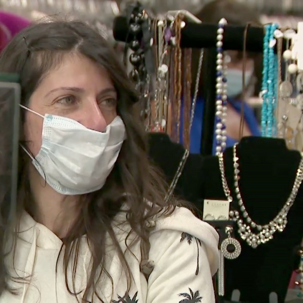 A masked woman shops in a La Mesa store on Thursday, after retail stores were allowed shoppers inside their businesses again.