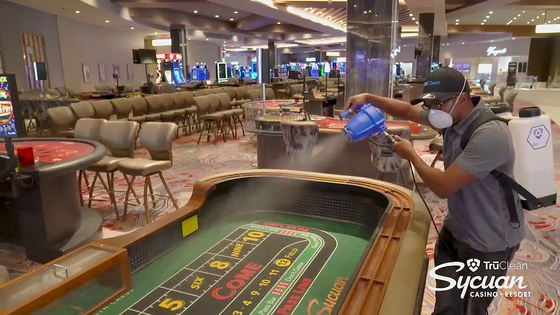 A worker sprays disinfectant on a craps table at Sycuan Casino (Video: Sycuan Casino)