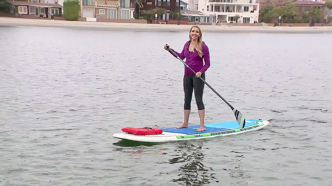 Heather Lake paddleboards on Mission Bay.