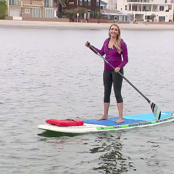 Heather Lake paddleboards on Mission Bay.