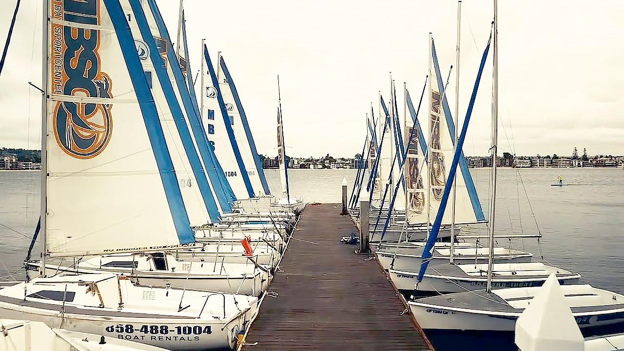 Rental sailboats at a dock on Mission Bay