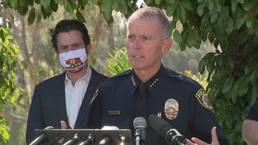 La Mesa Police Chief Walt Vasquez answer questions during a tense news conference Wednesday.