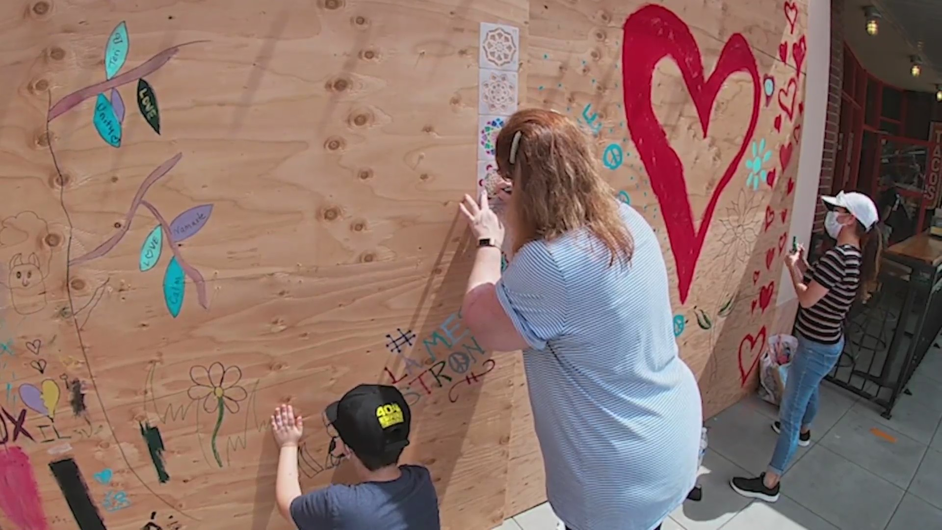 La Mesa residents decorated boarded up storefronts three days after a riot broke out in there small town.