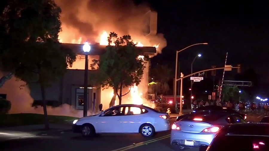 A building burns in downtown La Mesa during rioting on May 30.