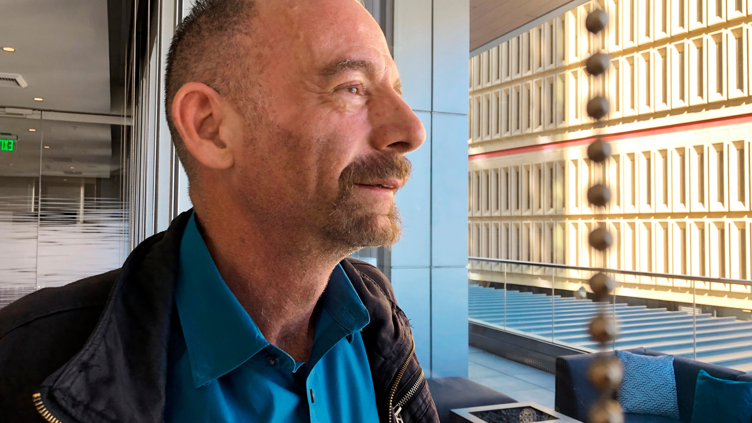 FILE - This March 4, 2019, file photo shows Timothy Ray Brown, nicknamed the Berlin patient, posed in Seattle. A Brazilian man who was infected with the AIDS virus has shown no sign of it for more than a year since he stopped HIV medicines after an intense drug therapy aimed at purging hidden, dormant virus from his body, doctors are reporting. If confirmed, this would be the first time HIV has been eliminated without a bone marrow or stem cell transplant like the ones that have cured two other men, nicknamed the Berlin and London patients for where they were treated. (AP Photo/Manuel Valdes, File)