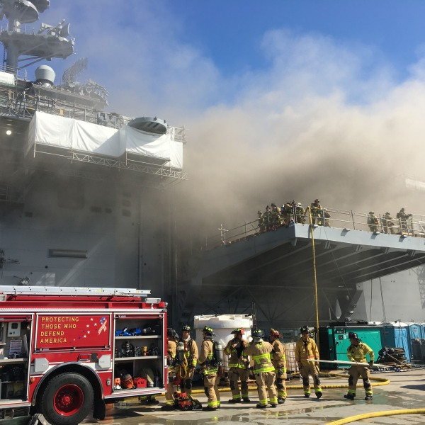 SAN DIEGO , CA - JULY 12: Sailors and Federal Fire San Diego firefighters combat a fire aboard the amphibious assault ship USS Bonhomme Richard (LHD 6), July 12, 2020. On the morning of July 12, a fire was called away aboard the ship while it was moored pierside at Naval Base San Diego. Local, base and shipboard firefighters responded to the fire. USS Bonhomme Richard is going through a maintenance availability, which began in 2018. (Photo by Mass Communication Specialist 1st Class Jason Kofonow/U.S. Navy via Getty Images)