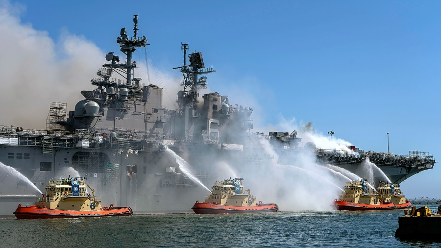 AN DIEGO , CA - JULY 12: In this U.S. Navy released handout, Sailors and Federal Firefighters combat a fire onboard USS Bonhomme Richard (LHD 6) at Naval Base San Diego, July 12. On the morning of July 12, a fire was called away aboard the ship while it was moored pierside at Naval Base San Diego. Local, base and shipboard firefighters responded to the fire. USS Bonhomme Richard is going through a maintenance availability, which began in 2018. (U.S. Navy photo by Mass Communication Specialist 3rd Class Christina Ross)