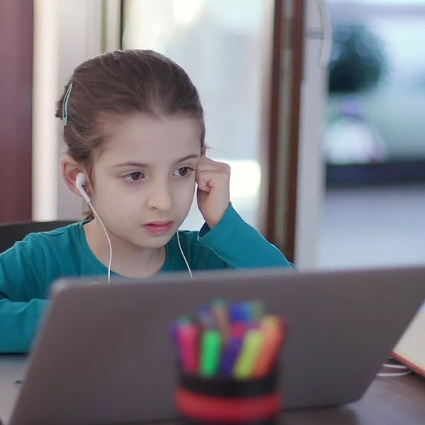 A child participates in an online class.