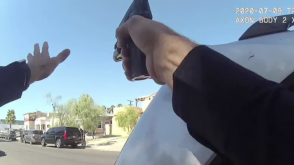 A still frame from body camera video recorded by a San Diego police officer just before he and other officers shot a man who they say refused their commands and pointed a gun in their direction. (Video: San Diego Police Department)